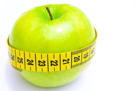 enveloped: Apple enveloped measuring centimeter isolated on white background, Healthy diet, photography Stock Photo