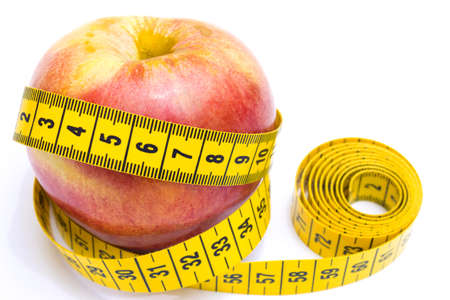 enveloped: Apple enveloped measuring centimeters isolated on white background, Healthy diet, photography