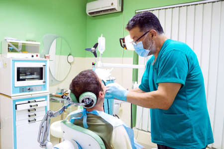 Dentist fixes the patient's teeth, Photography