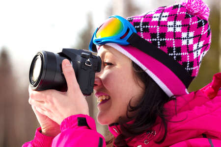 Smiling young woman shoots winter's nature, All Winter's Magic, Photography