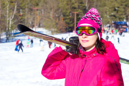 winters: Woman carries skis on the shoulder, All Winters Magic, Photography Stock Photo