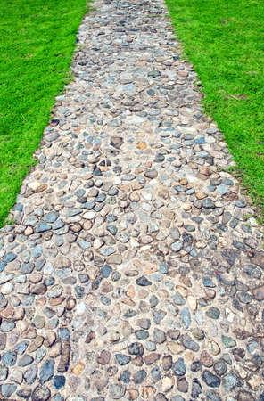 clear path: Sidewalk passage in green gras Stock Photo