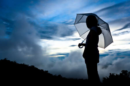 woman umbrella: Umbrella woman and sunset silhouette  Stock Photo