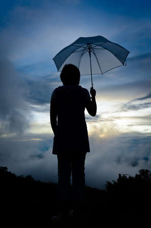 Umbrella woman and sunset silhouette  photo