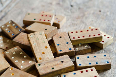 Wood domino game on wood background