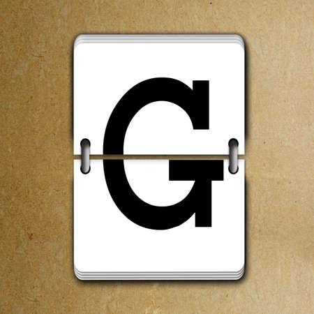 reversible: Letter G from mechanical scoreboard alphabet Stock Photo