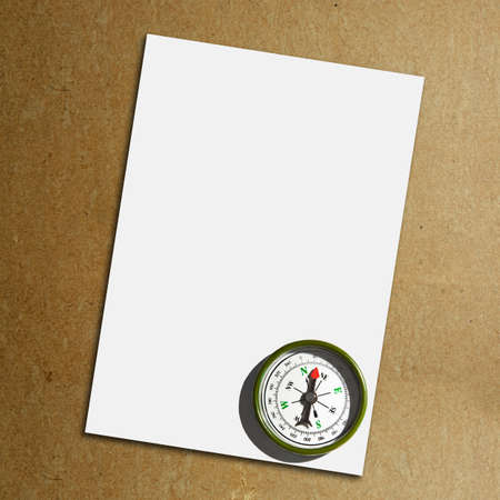 Close up view of the Compass on the white paper background