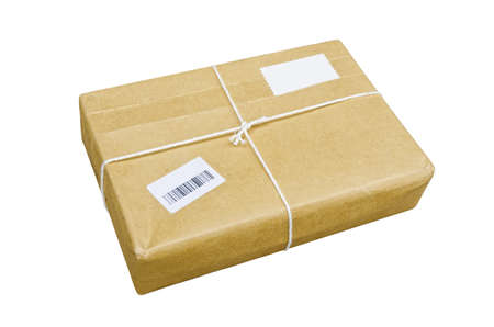 A parcel wrapped in brown paper and tied with rough twine and two blank labels, isolated on white background.
