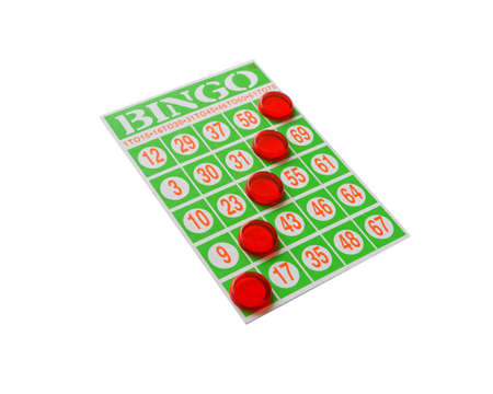 Green bingo card with winning chips