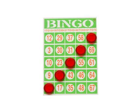 Green bingo card with winning chips