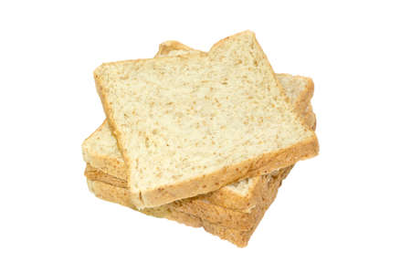 wholemeal: several slices of whole grain bread over a white surface  Stock Photo
