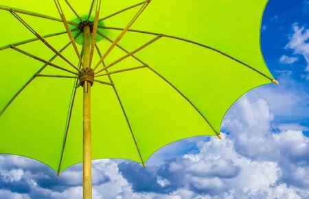 The green umbrella   bluesky clouds background photo