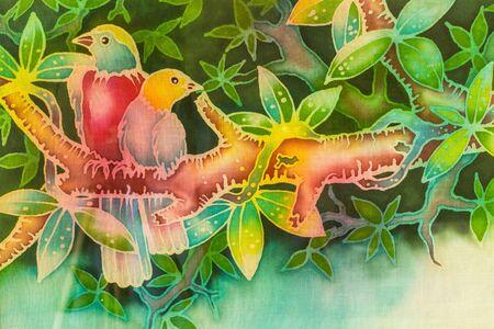 bir: Batik two bir colourful on a tree