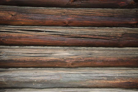 Fragment of old country wooden house wall, useful as background photo