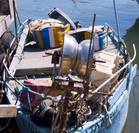 fishnets: Fishing boat with fishnets on a mooring. Stock Photo