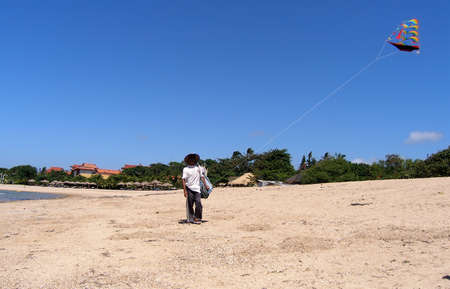 The seller with a kite on the bank of Indian ocean Stock Photo - 5201252