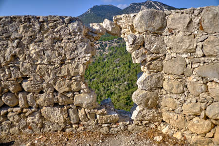 The hole in the wall of the castle Monolithos 2018