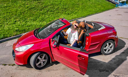 Pregnant girl next to her convertible in summer 2019 Reklamní fotografie
