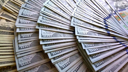 American dollars background. Old and new 100 usd banknotes. For financial news
