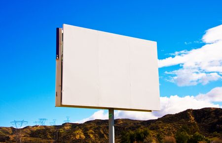 White blank roadside billboard on the sky background