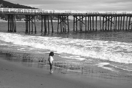 Picture of a little girl staying on the sea shore