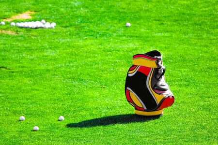 picture of a golf bag on the grass Stock Photo