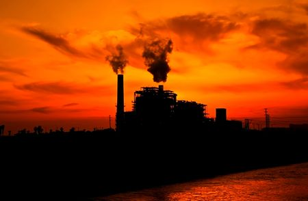 Picture of a factory on the sunset background