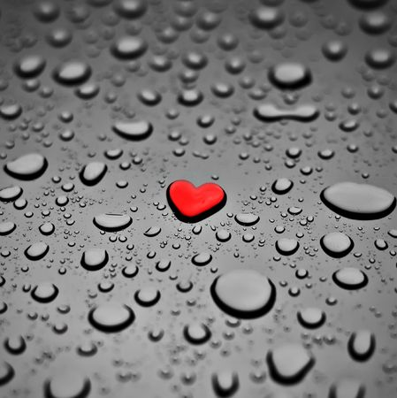 with reflection: Red heart as a rain drop on the grey background