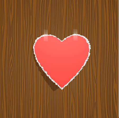 Torn paper heart on wood background. Vector
