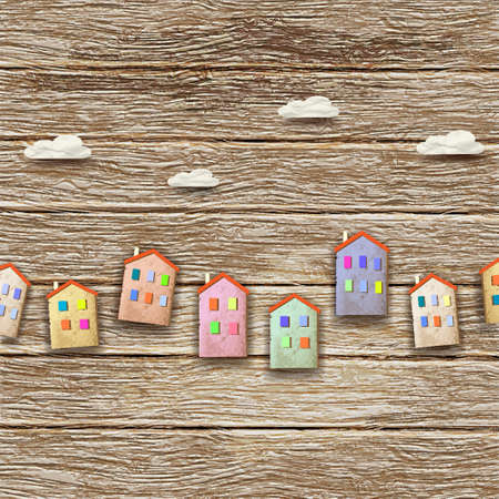 realestate: Colorful homes made from old paper on wooden background