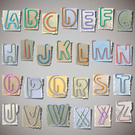 paper spell: Alphabet letters made from paperclip on old paper