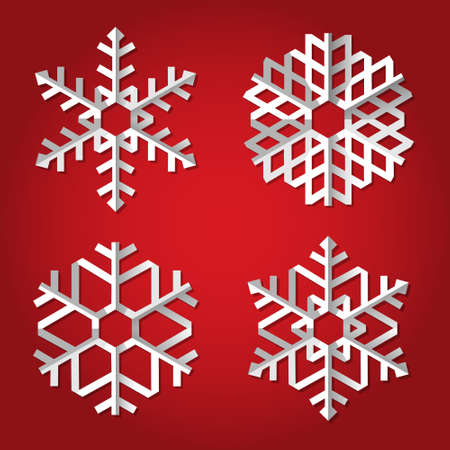 paper fold: Christmas origami snowflakes on red background.