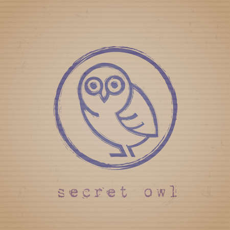 owl symbol: Rubber stamp of owl on cardboard
