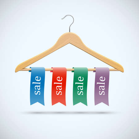 clothing tag: Sale concept - wooden hangers with colored ribbons
