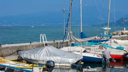Many yachts and motor boats parked in a small port Stok Fotoğraf