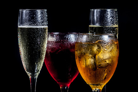 Several glasses of different drinks photo