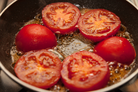 Whole tomatoes on pan