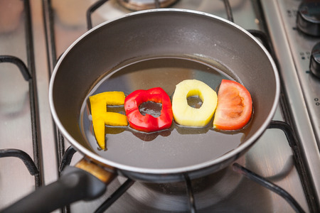 Food word written with letters formed from vegetables