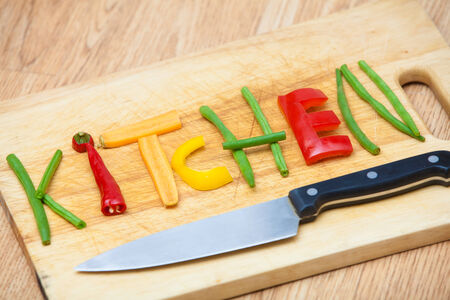 Kitchen as a sign for cooking, cuisine, chefs, food and drink