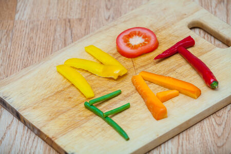 No fat, word written with letters formed from vegetables