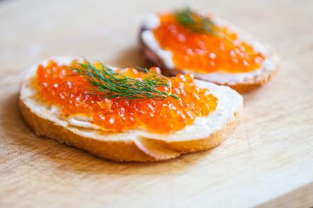 Red caviar sandwiches Фото со стока