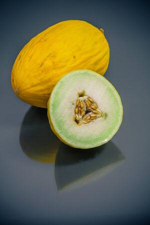 fresh yellow korean melon cut and whole closeup Фото со стока