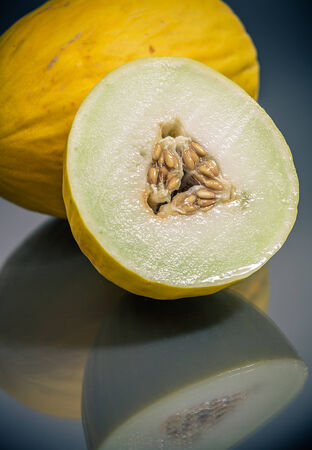fresh yellow korean melon cut and whole closeup Standard-Bild