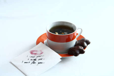 hot chocolate drink: tea and a letter on the table with cookies