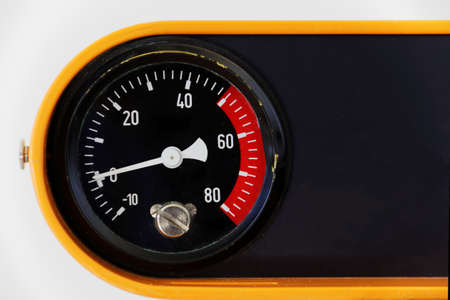 a clock for measuring the pressure, indicator