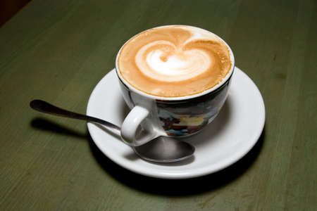 Cup of cappuccino on the cafe table photo