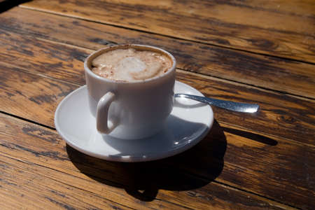 Cup of cappuccino on the table photo