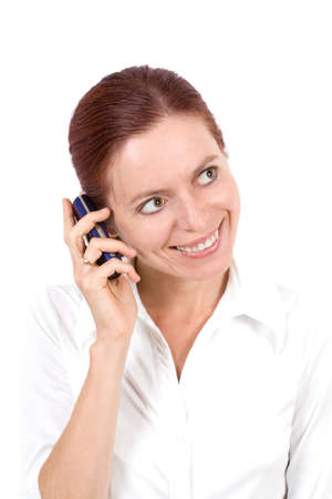 Young smiling woman with cellular phone isolated on the white photo