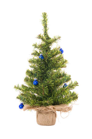 Christmas tree with blue christmas balls on the white photo