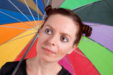 Young woman on the rainbow umbrella background photo